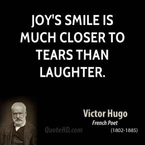 Joy's smile is much closer to tears than laughter.