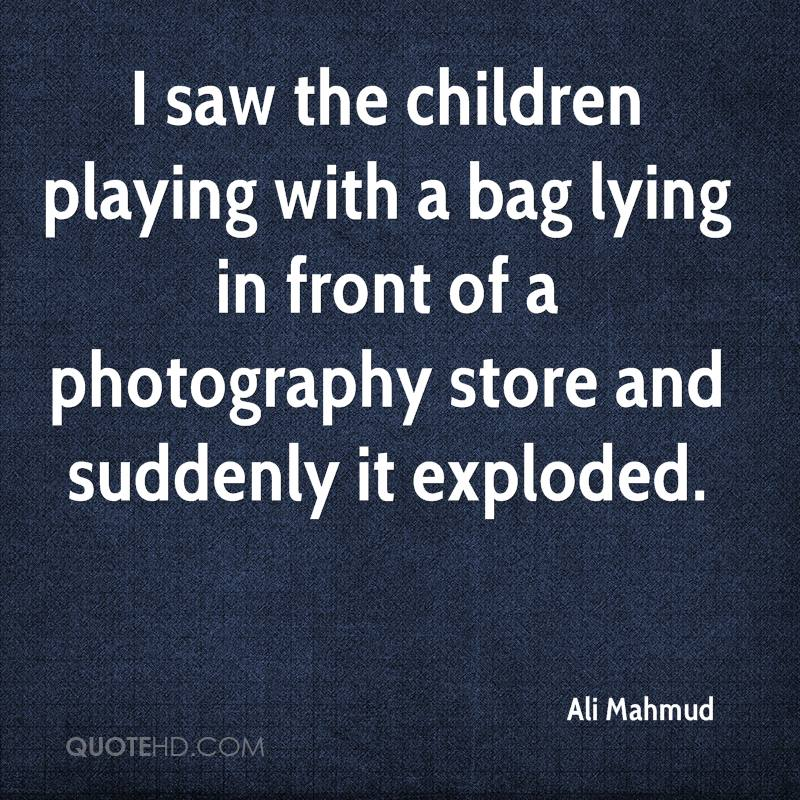 saw the children playing with a bag lying in front of a photography ...