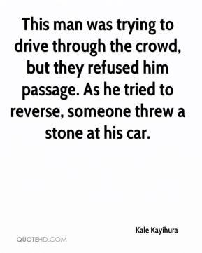 Kale Kayihura  - This man was trying to drive through the crowd, but they refused him passage. As he tried to reverse, someone threw a stone at his car.