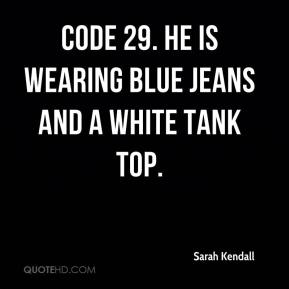 Sarah Kendall  - Code 29. He is wearing blue jeans and a white tank top.