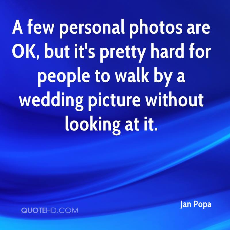 A few personal photos are OK, but it's pretty hard for people to walk by a wedding picture without looking at it.