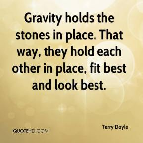 Gravity holds the stones in place. That way, they hold each other in place, fit best and look best.