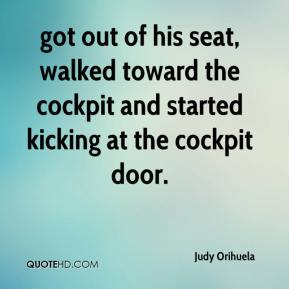 Judy Orihuela  - got out of his seat, walked toward the cockpit and started kicking at the cockpit door.