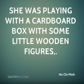 She was playing with a cardboard box with some little wooden figures.