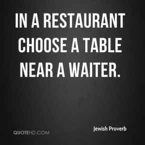 In a restaurant choose a table near a waiter.