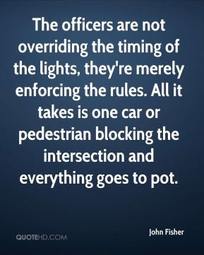 The officers are not overriding the timing of the lights, they're merely enforcing the rules. All it takes is one car or pedestrian blocking the intersection and everything goes to pot.