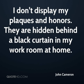 I don't display my plaques and honors. They are hidden behind a black curtain in my work room at home.